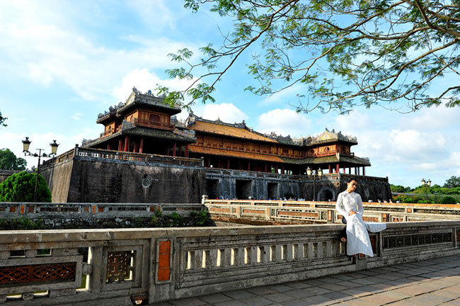 Hue Imperial Citadel with ao dai girl